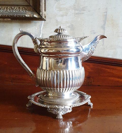 Regency sterling silver coffee pot on original stand c 1815